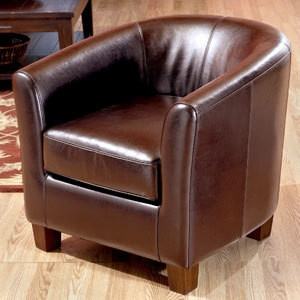 World Market: Bi Cast Leather Chair And Ottoman.