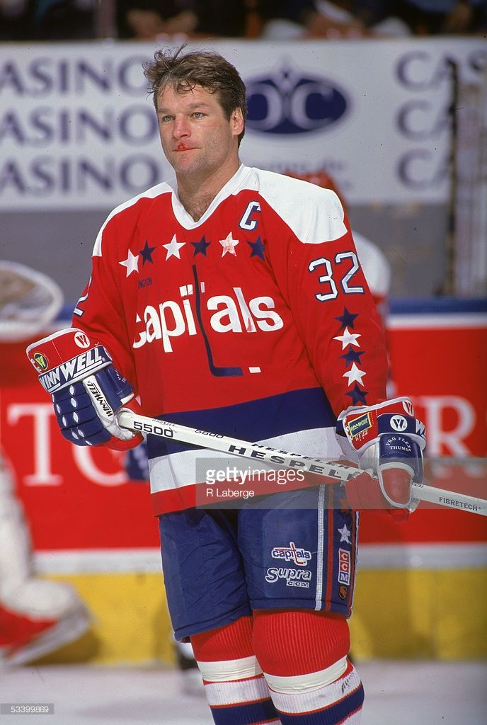 Canadian professional hockey player Dale Hunter of the Washington Capitals  with a cut on his upper lip during a road game b8e5a7f5175