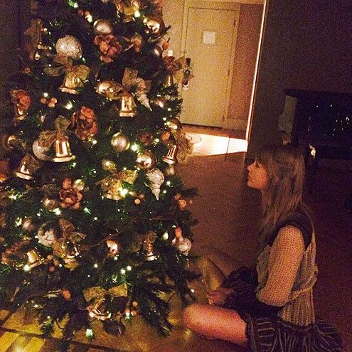 "Celebrities' Christmas Trees Taylor Swift ""There's a Christmas tree in my hotel room and I'm really happy about it."""