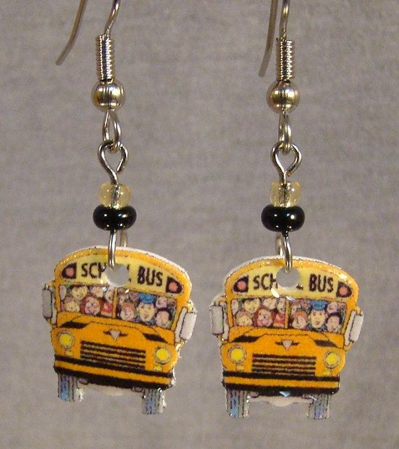 These lightweight dangle earrings feature print art of a cartoon school bus. Awesome gift idea for a bus driver Handmade altered art Made with acrylic, resin, base metal connectors and surgical steel ear wire. Hightlighted with glass beads. Measure 1 3/4 long 2nd through 4th item ship free Visit www.afanaffair.com or the Wearable Memories shop section on Etsy to find out how to put your own photos on jewelry Like us on facebook or follow us on twitter for money saving coupons and offers