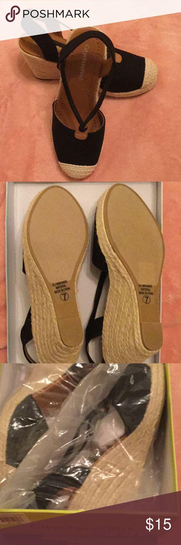 Black linen closed toe espadrilles Black and linen wedge espadrilles.  The wedge is 3.5 inches with a 1 inch plate form. Shoes Espadrilles
