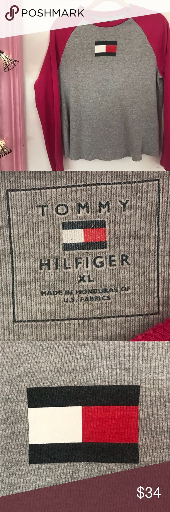 Tommy Hilfiger Flag Raglan Top Small/Medium This is a Tommy Hilfiger Flag raglan and fits as a small/medium. Tag reads XL puts fits smaller. Very cute with the Tommy Hilfiger Flag on the front and looks great tucked into a pair of jeans. Bundle up! Tommy Hilfiger Tops