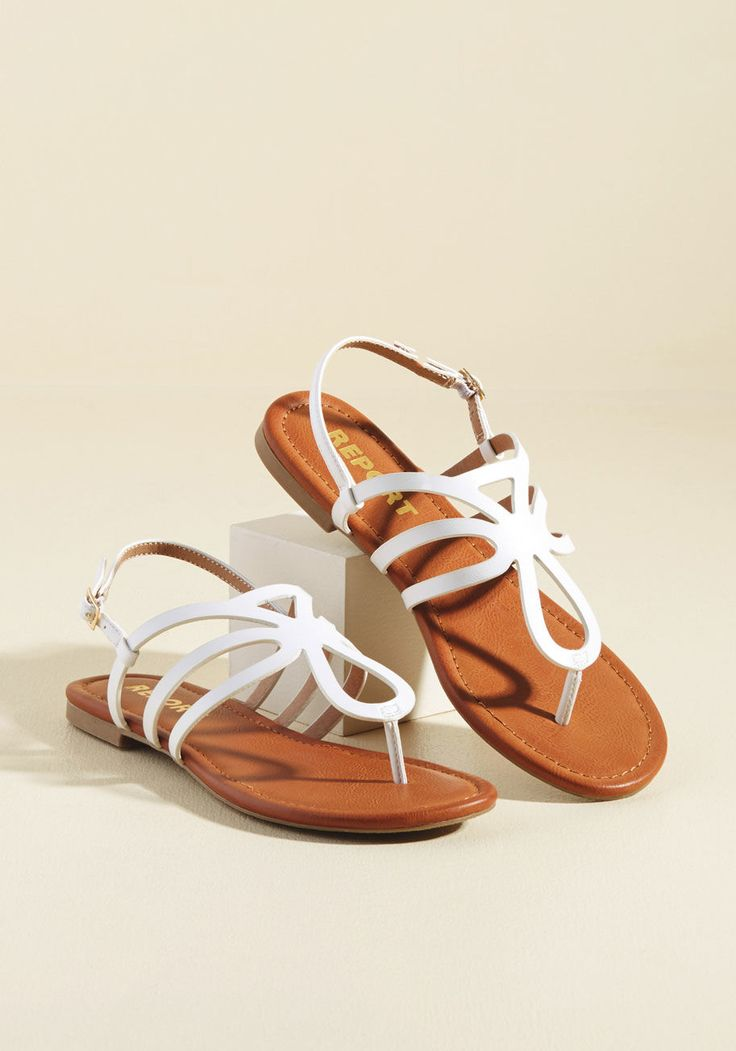 <p>You love nothing more than classic styles being reimagined, so it's no wonder these tan sandals by Report Footwear are your brand new fave! Taking a traditional T-strap silhouette and amping it up with a collection of rounded cutouts, these faux-leather flats encourage your sartorial creativity.</p>