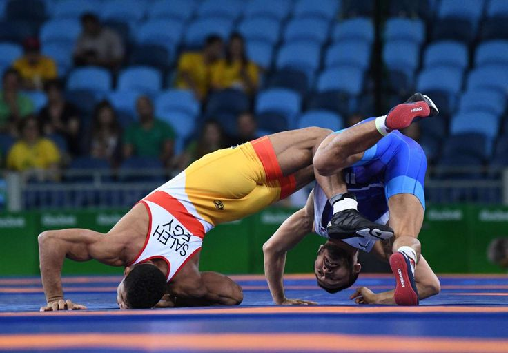 Adham Ahmed Saleh Kahk (EGY) competes against Hansu Ryu (KOR) during the men's wrestling Greco-Roman 66kg repechage round in the Rio 2016 Summer Olympic Games at Carioca Arena 2.    -   Rio Olympics: Best images from Tuesday, Aug. 16