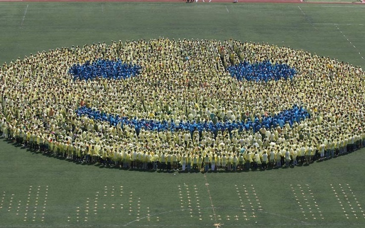 Students stand together to create the world's biggest human smiley on a soccer pitch at a university in Nanjing, China. The smiley was made with help of of 3,110 people. The previous Guinness World Record was made by 768 Croats in Zagreb on May 6, 2011.