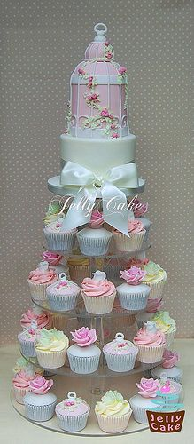 Colorful wedding cupcakes with a birdcage on top