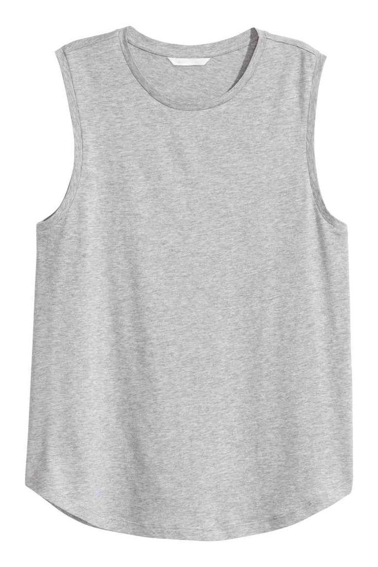 Camiseta sin mangas: Camiseta sin mangas en punto suave de algodón y modal con bajo ligeramente redondeado.