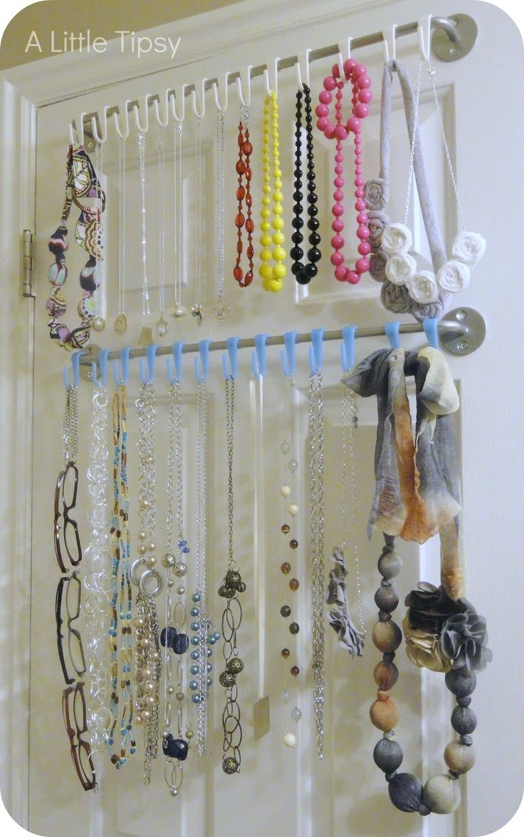 Shower curtain or regular curtain rod as a jewelry organizer! I guess this is better than my using tacks method