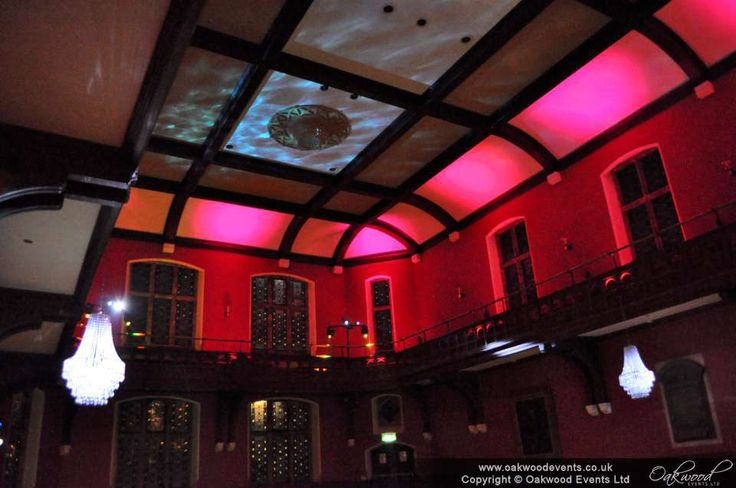 Red and pink uplighting on the balcony to flood the roof with light