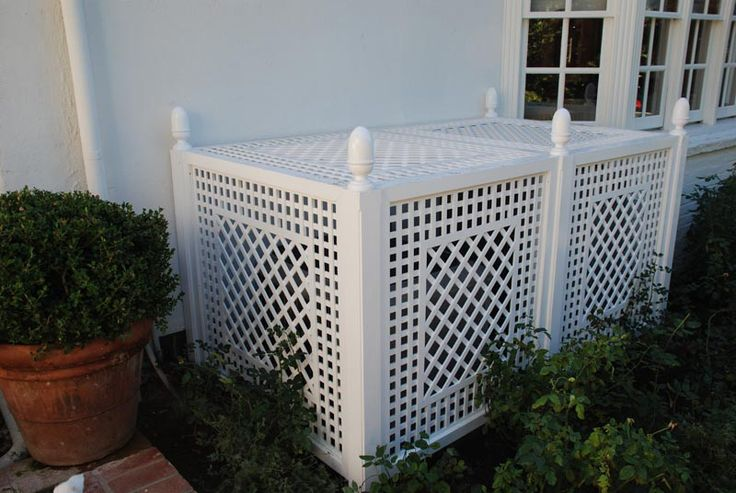 ac unit treillage by Accents of France--- yes covering the ugly AC is a good idea