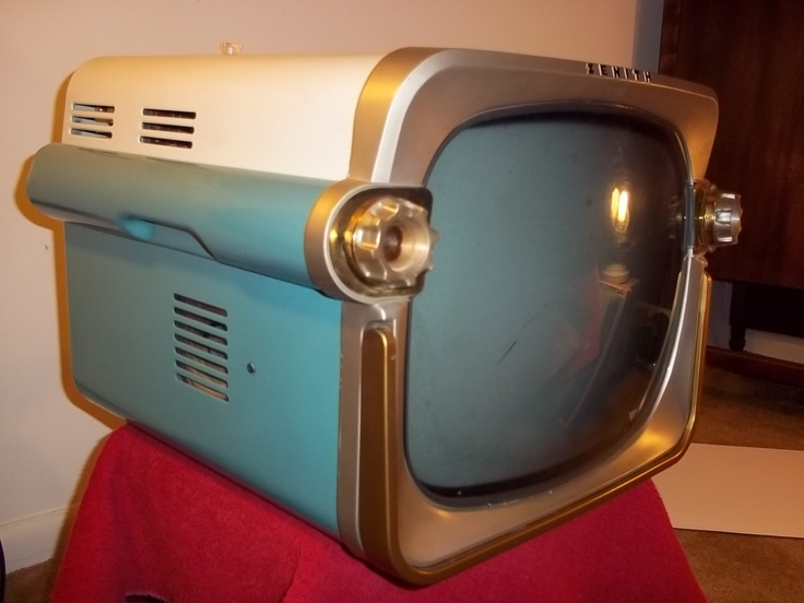 Vintage 1957 Zenith Portable Television It looks like the back of a car with brake lights.