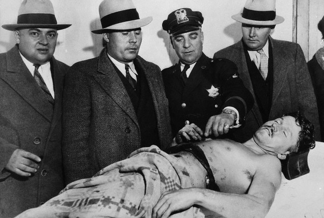 George 'Baby Face' Nelson, member of the Dillinger gang lies dead on an undertakers slab after his assassination in 1934.