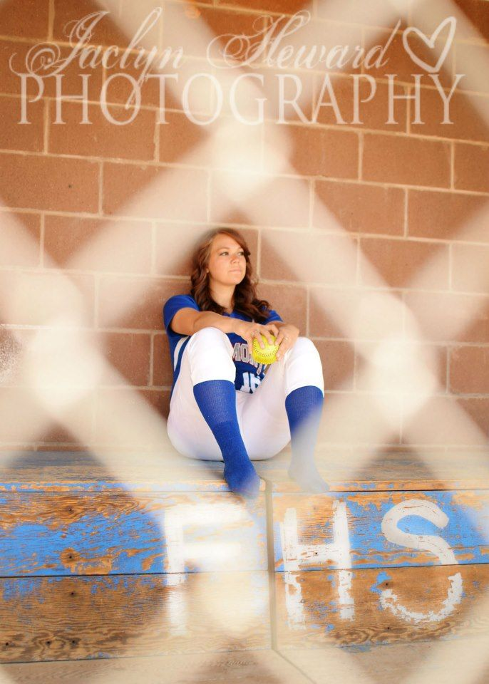 Softball senior girl photo ideas.  Through the fence.  dug out.  Jaclyn heward Photography
