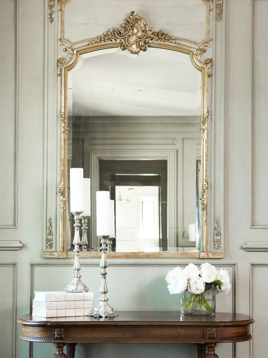 Beautiful bedroom with french gray green paneled walls a for Grand miroir antique