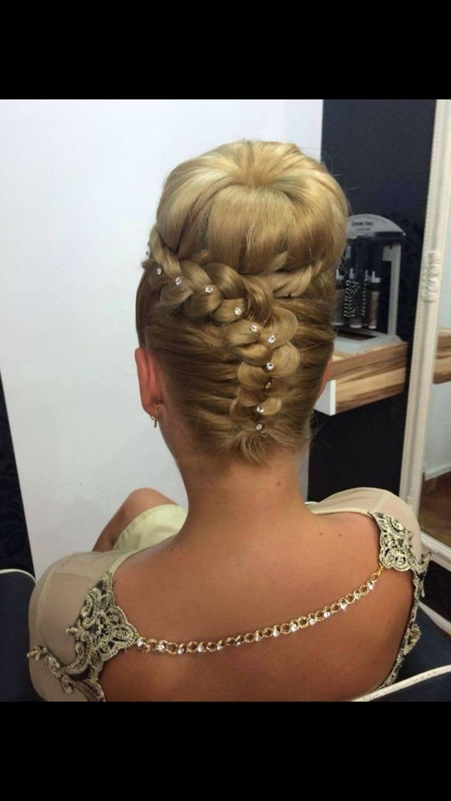 I really like this one.  So, so pretty.  The inverted braid into the high bun is gorgeous.  I'd love to try this on a guy with pretty blonde hair.