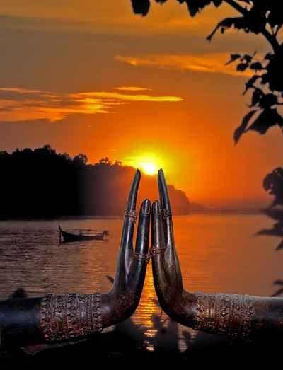 ::Buddha hands holding the Sun.
