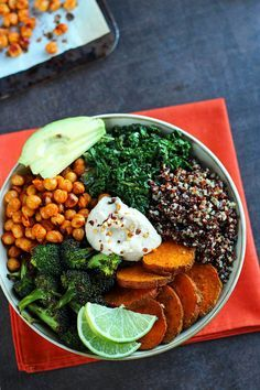 Veggie Quinoa Bowl |  If you are plagued by the winter blues, this veggie quinoa bowl is a bright and cheerful meal that will change your mood. Chili-lime kale, garlic roasted broccoli, curry roasted sweet potato rounds, and roasted soy sauce and sriracha chickpeas sit on a bed of perfectly cooked quinoa.  Every independent bite is exploding with flavor and the combination is dynamite. @ilovevegan
