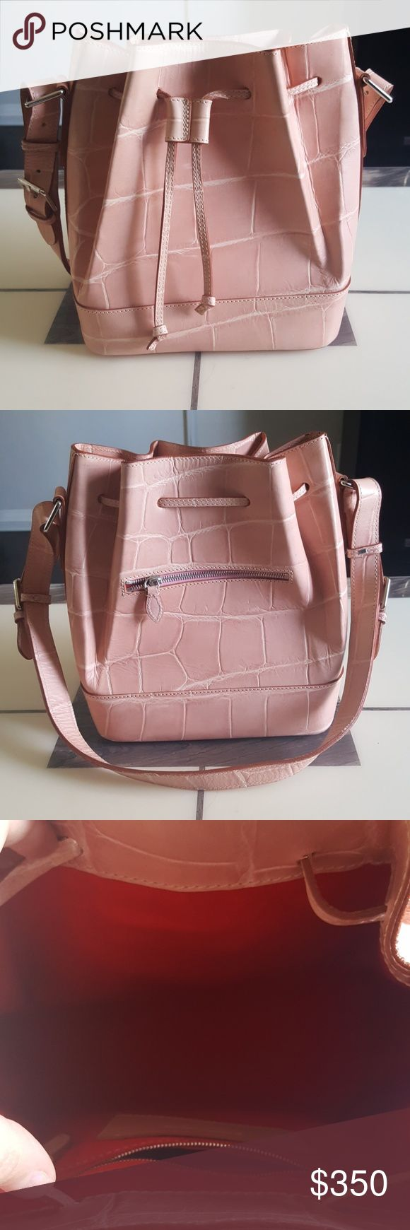 Rare Dooney and Bourke Pink Croco embossed handbag Brand new Dooney & Bourke Large Pink Croco embossed drawstring handbag. Beautiful, fits a lot, made in Italy - Leather. Make me a reasonable offer :) Dooney & Bourke Bags Crossbody Bags