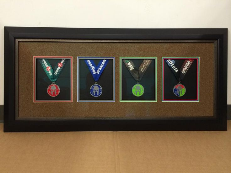 Framed my Spartan Trifecta medals as a sample for my frame ...