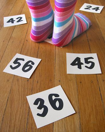 Math Facts Game: A mix of musical chairs and Twister meets math. Nipping multiplication problems in the bud was never this much fun!