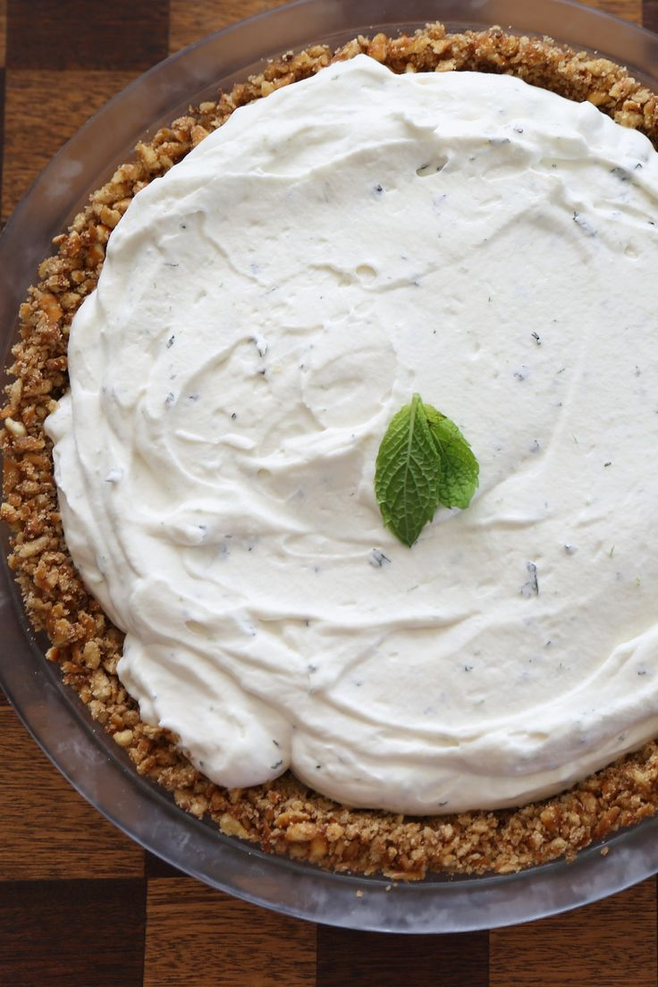 This recipe for frozen mojito pie is a must make (again . . . and again) before Fall sets in. The frozen pie filling has the same fluffy, slow-to-melt consistency of the ice cream in ice cream sandwiches. It's almost like key lime pie — but with a cool finish due to the mint. And let me tell you about the salty pretzel crust. You will want to make pie after pie with this stuff.