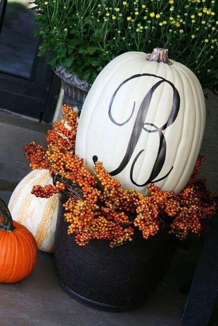 Monogrammed white pumpkin decor.