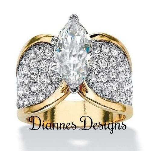 Details Yellow Gold Plated Center Stone Grade AAA CZ Base Metal Brass High Polish Ring Size US Standard Shipping We Package Your Order With