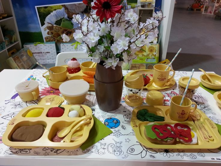 Mother's Corn at KIS Trade Show 2013. They're not a toy - they're actual tableware made of CORNSTARCH for children to eat off. It is not a PLASTIC! All natural & non-toxic for babies & kids!