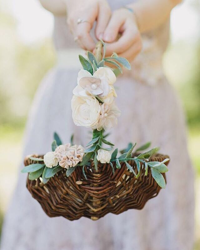 Flower girl with basket of silk white rose petals