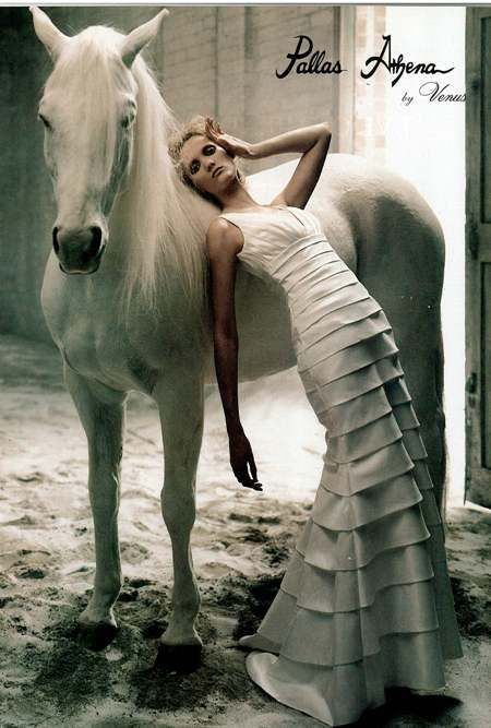 this horse looks very unimpressed by the models pose...especially seeing as she seems to just be trying to keep from getting the dress dirty...JMO lol