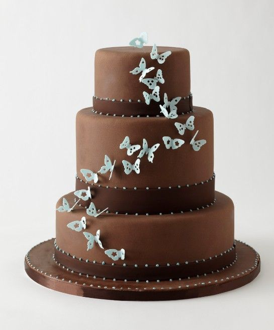 """brown & blue """"butterfly"""" wedding cake... three tiers with light mocha brown & some chocolate brown accented with light blue butterflies fluttering up the cake..."""
