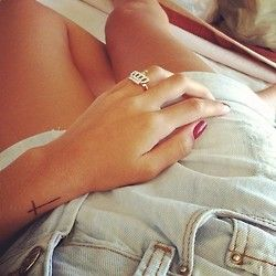 Love this cross tattoo--check out the crown ring too cute