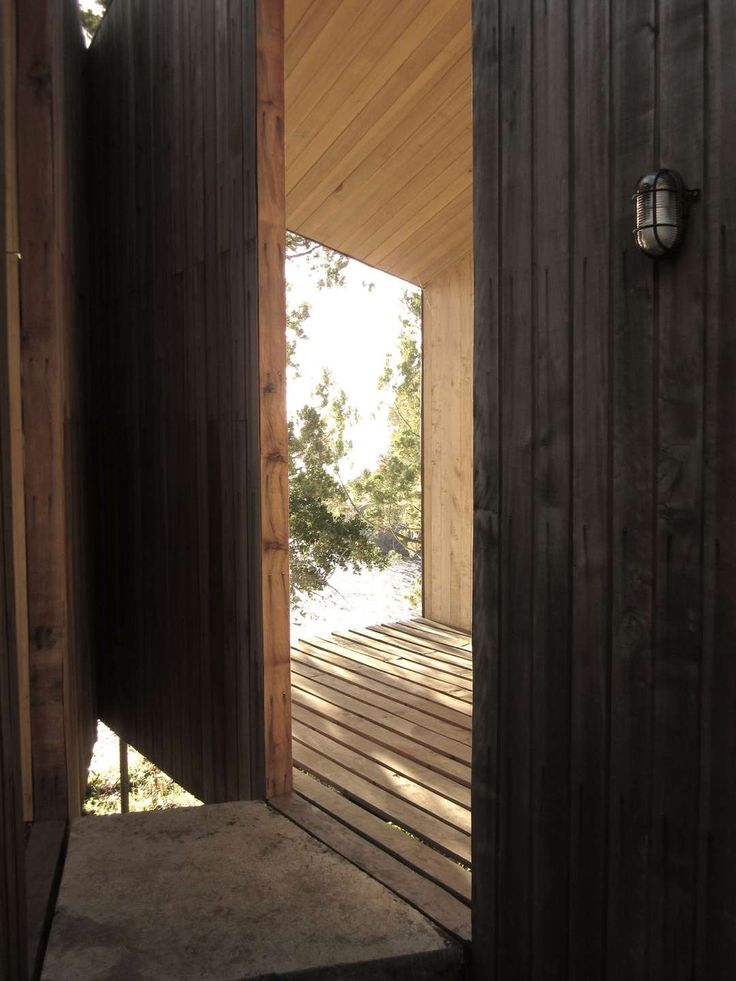 The project is situated in Ranco in the lake district – Chile, over a dark granite rock at the shore surrounded by mountain cypresses. The project consists o...