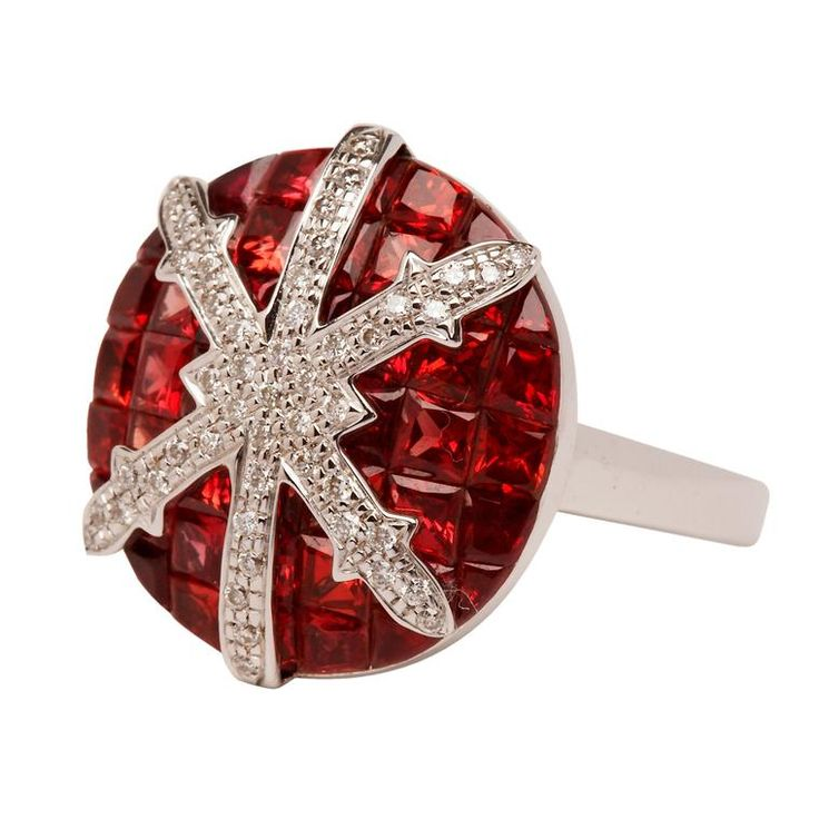 The Snowflake red sapphire and white diamond ring by Stenmark creates a bold contrast between the deep red tones of the red sapphires and the white diamonds. Discover more jewellery for Christmas: http://www.thejewelleryeditor.com/shop/product/stenmark-snowflake-red-sapphire-and-white-diamond-ring/ #jewelry