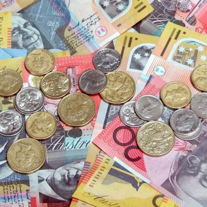 The Australian dollar falls back below 70 US cents in response to New Zealand's third interest rate cut since June.