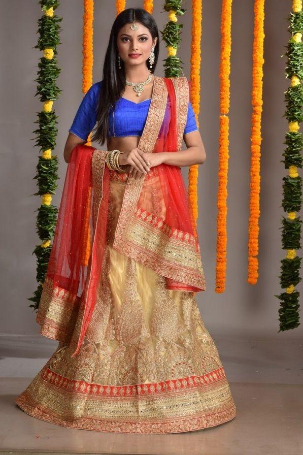 Buy #designerlehenga online from our #onlinestore. Red and beige color all over body #zardosi work #designer #lehenga.