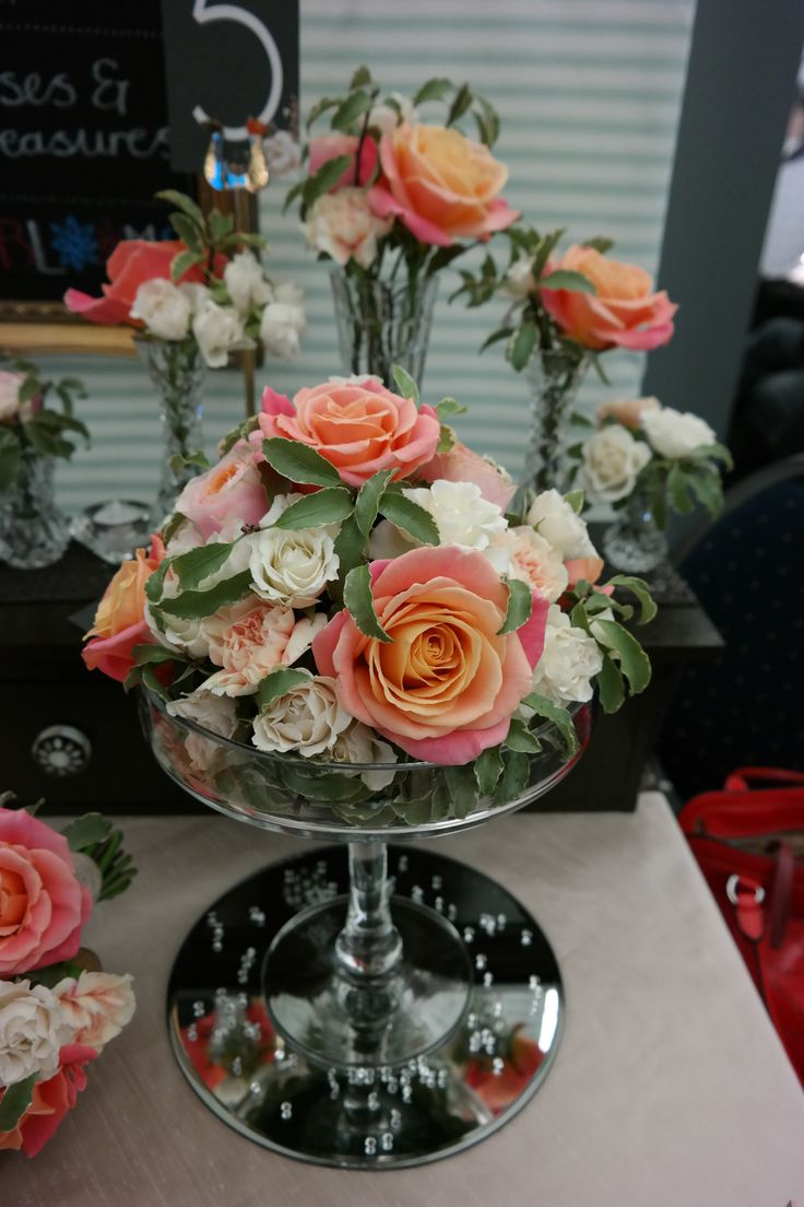 Miss Piggy roses in a champagne glass centrepiece.