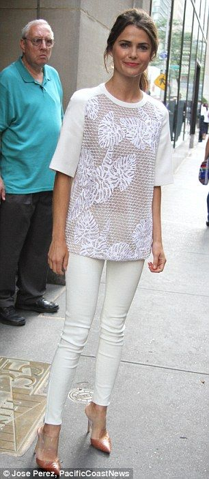 Minimalist: The 38-year-old actress finished off her summery style with an embroidered top and nude pumps as she signed autographs outside R...