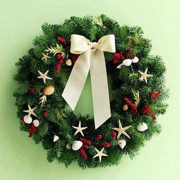 Infuse a standard evergreen wreath with the flavor of the sea. Pair shells and small starfish with holly berries in a random pattern around the ring. Hot-glue in place and finish your creation with a pretty ribbon bow.