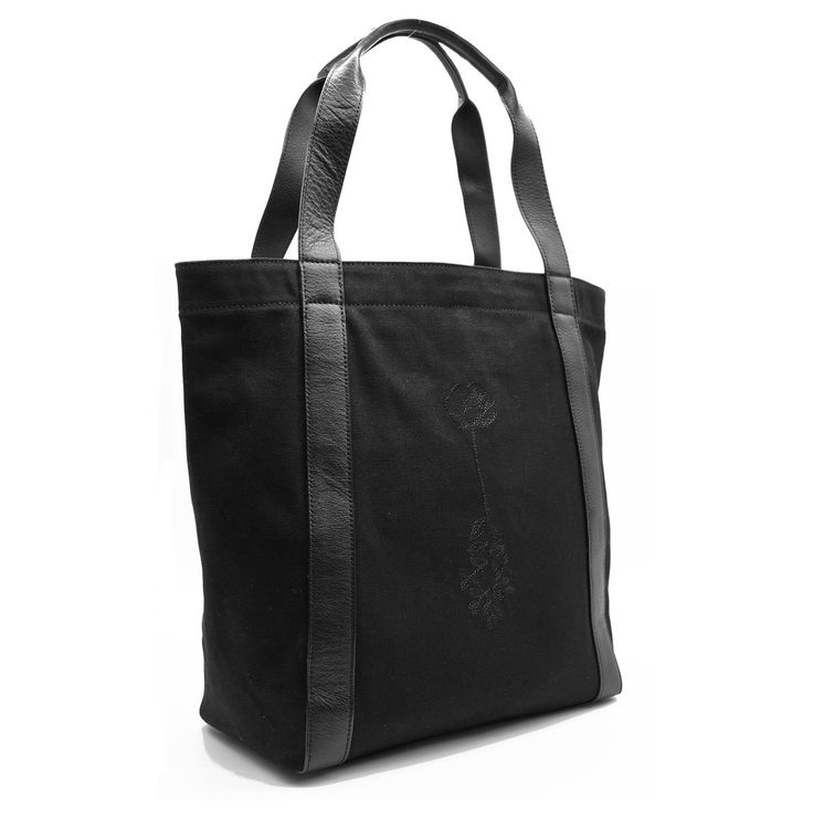 Made with 100% cotton black canvas, this carryall tote is embroidered with floral detail, designed by Pearl & Marmalade, a Chicago-based paper...