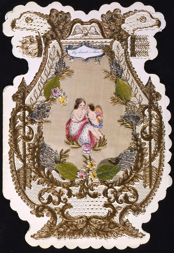 Paper lace valentine card with fabric and scraps, and envelope. Gilt paper lace with eagle heads at top on shaped card. Central panel filled with cream fabric. In the centre of the fabric is a hand-painted woman with cupid. Gilt embossed floral scraps with silver and green leaves. Accompanying envelope addressed to Gravesend. c.1850 (OB1995.291)