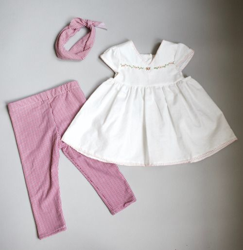 Baby summer outfit trio. Red jeggings, headband and white dotted swiss embroidered blouse.