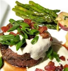 Recipe For Grilled Filet Mignon with Gorgonzola Cream Sauce - Tender filet mignon is drizzled with a savory gorgonzola cream sauce and topped with crumbled bacon bits and sliced green onion.