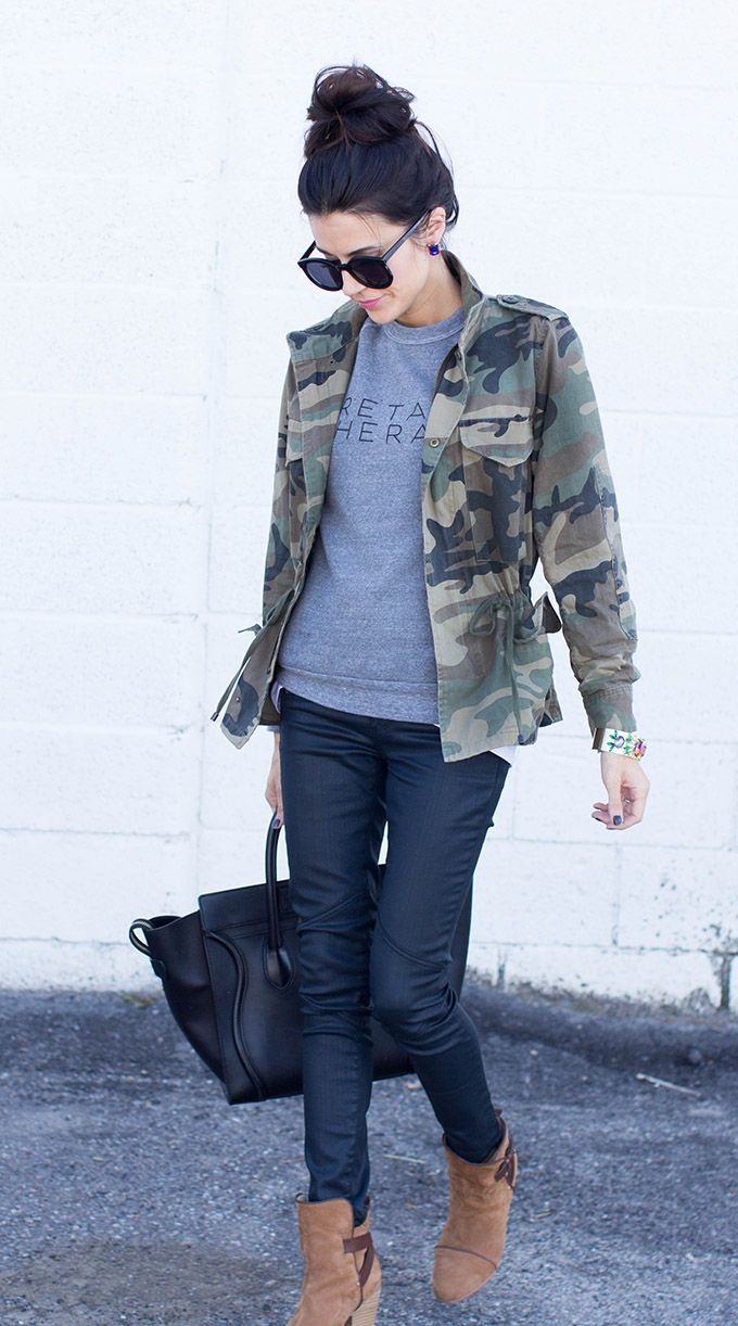 Shop this look for $109:  http://lookastic.com/women/looks/military-jacket-and-crew-neck-sweater-and-jeans-and-shopper-handbag-and-ankle-boots/1487  — Dark Green Camouflage Military Jacket  — Grey Print Crew-neck Sweater  — Navy Jeans  — Black Leather Shopper Handbag  — Tan Suede Ankle Boots