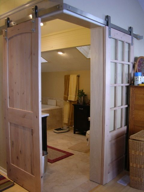 Link to website for ordering barn-style door tracks.  Door from master bedroom to master bath?