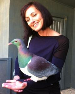 Natasha Hayward, Operations Manager based in Te Kuiti with a kererū at Otorohanga Kiwi House. #nzbirds