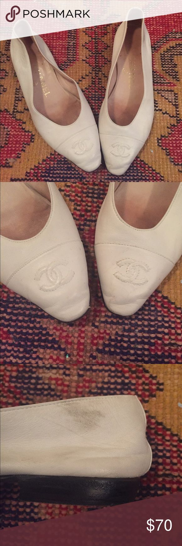 Chanel Flats Soft white leather Chanel flat. Small scuff, could possible be removed with the right white shoe polish. Chanel Shoes Flats & Loafers