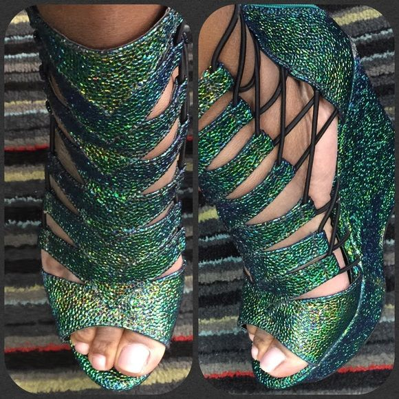 Emerald green wedges worn once Emerald green wedges perfect for the holidays Rouge Shoes Wedges