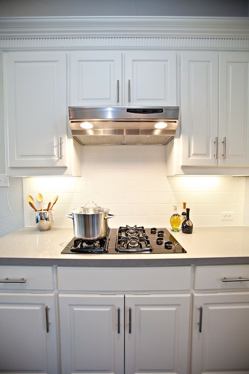White Kitchen Cabinets, Stainless Steel Hood, Subway .