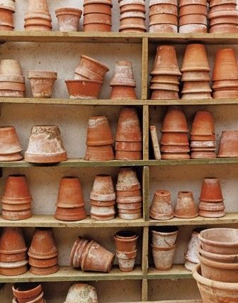 Love these stacks and stacks of flower pots!